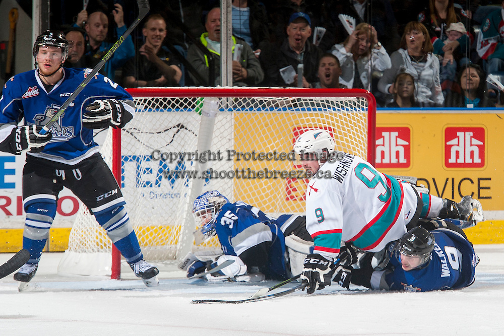 KELOWNA, CANADA - APRIL 14: Tanner Wishnowski #9 of Kelowna Rockets collides with Jack Walker #9 and Coleman Vollrath #35 of Victoria Royals during third period on April 14, 2016 at Prospera Place in Kelowna, British Columbia, Canada.  (Photo by Marissa Baecker/Shoot the Breeze)  *** Local Caption *** Tanner Wishnowski; Coleman Vollrath; Jack Walker;