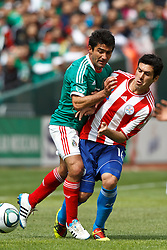 March 26, 2011; Oakland, CA, USA;  Paraguay midfielder Cristian Riveros (16) is pushed off the ball by Mexico midfielder Antonio Naelson Sinha (17) during the first half at Oakland-Alameda County Coliseum. Mexico defeated Paraguay 3-1.