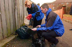 Council Housing Management staff seeking evidence of ownership of fly-tipping sacks during an Estate Inspection carried out in North Shields. UK