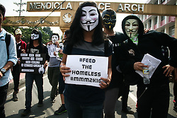 November 5, 2016 - Philippines - Members of Anonymous Philippines marched to Mendiola Bridge in Manila to participate in the global Million Mask March. Wearing Guy Fawkes masks, the group distributed food packs to the needy as they march to air their call to feed the homeless. (Credit Image: © J Gerard Seguia via ZUMA Wire)