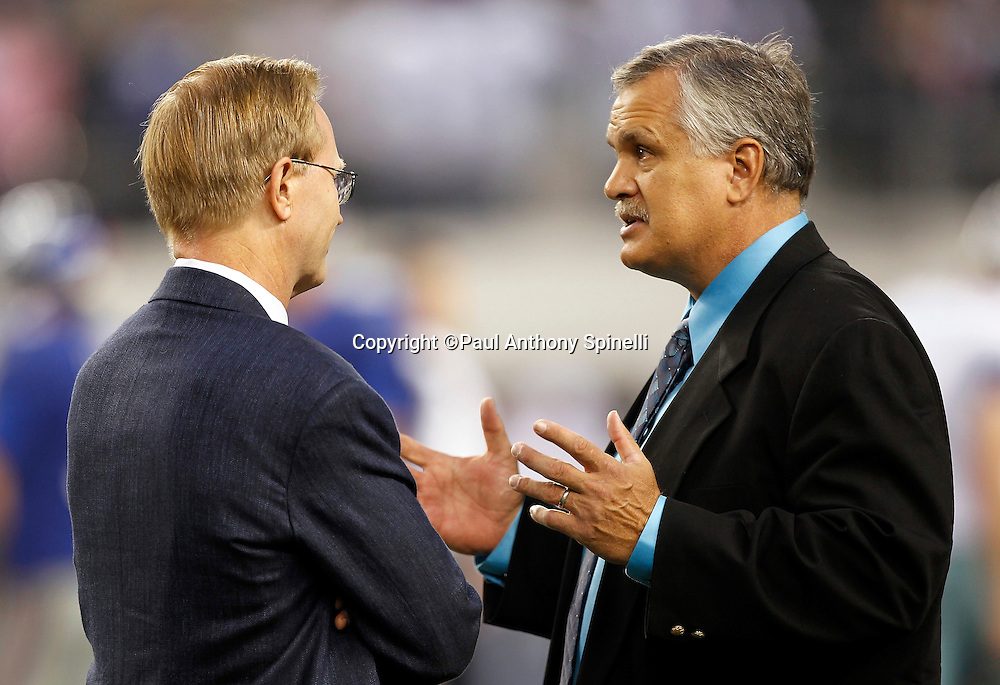 New York Giants President and CEO John Mara talks to ESPN analyst Matt Millen (right) before the NFL week 7 football game against the Dallas Cowboys on Monday, October 25, 2010 in Arlington, Texas. The Giants won the game 41-35. (©Paul Anthony Spinelli)