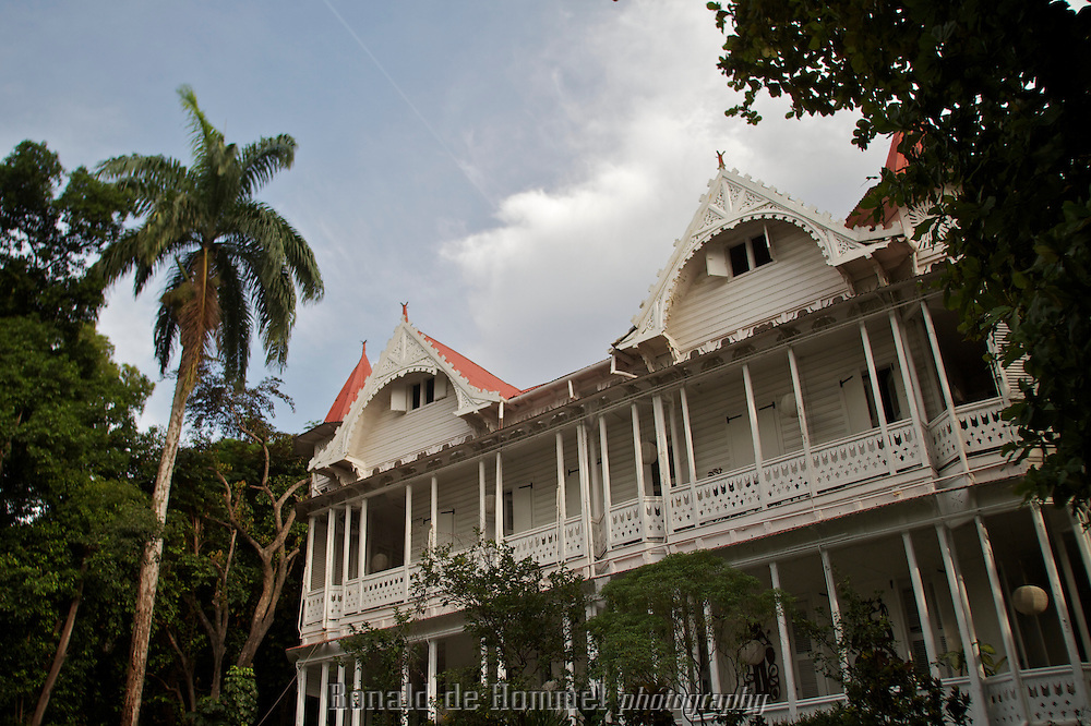 At the turn of the 19th century, Port au Prince witnessed a blossoming of ornate architecture - taking a bit of style from New Orleans and some inspiration from Europe, Gingerbread houses started to be built by the city's nobility. The ceilings are high, the wooden doors are curved at the top - Gingerbread architecture makes for cool elegant homes in Haiti's stifling climate..These houses are made mostly of wood with a small amount of brick, and they've proved surprisingly resistant to the shocks of January 12th's earthquake.