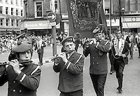 Twelfth, Belfast, N Ireland, 12th July 1969 - Flute band leads Orangemen through central Belfast on their way to The Field, Finaghy, South Belfast, N Ireland. 196907120189d<br />