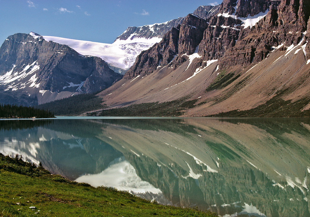The Canadian Rockies reflect lovely Bow Lake in Banff N.P., Alberta, Canada. ©Ric Ergenbright