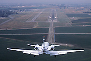 Cessna, Citation approaching the runway for landing at a small airport, Stockton, CA.
