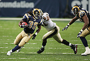 ST. LOUIS - SEPTEMBER 23:  Running back Steven Jackson #39 of the St. Louis Rams rushes for 97 yards and 2 touchdowns while avoiding a tackle by defensive end Will Smith #91 of the New Orleans Saints at the Edward Jones Dome on September 23, 2005 in St. Louis, Missouri. The Rams defeated the Saints 28-17. ©Paul Anthony Spinelli *** Local Caption *** Steven Jackson;Will Smith