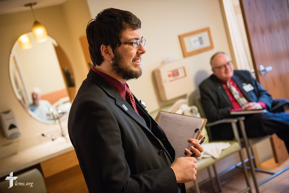 Seminarian Jacob Berlinski of Concordia Seminary, St. Louis, and the Rev. Doug Nicely (rear), chaplain at Memorial Hospital in Belleville, Ill., visits with a patient on Wednesday, Jan. 14, 2015. LCMS Communications/Erik M. Lunsford