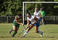 Bishop Brady's Lauren Roy and Gilford's Jillian Lachapelle during first half play of NHIAA Division III Field Hockey on Wednesday afternoon.  (Karen Bobotas/for the Laconia Daily Sun)