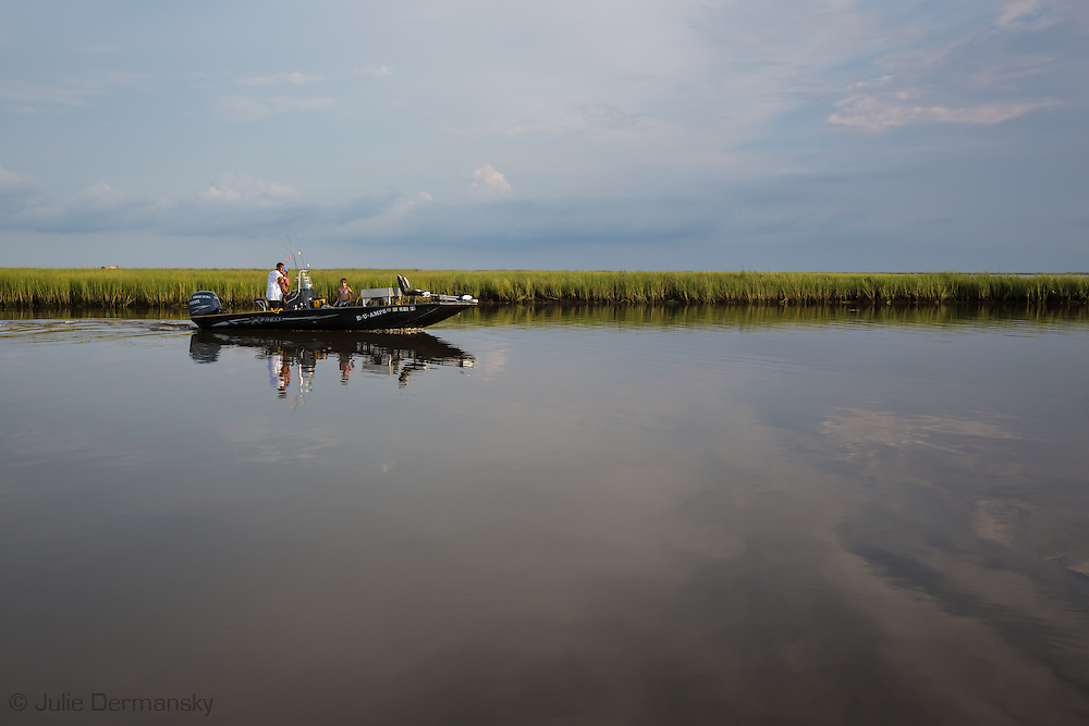 People fishing in the waters off Isle de Jean Charles deep in the bayous of Terrebonne Parish in South Louisiana. The marsh land is disappearing at a fast clip due to coastal erosion.