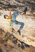 "Climber red pointing ""el celiaco"" route in Patones, Spain"