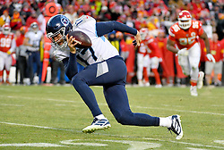 Jan 19, 2020; Kansas City, Missouri, USA; Tennessee Titans quarterback Ryan Tannehill (17) stumbles in the backfield during the AFC Championship Game against the Kansas City Chiefs at Arrowhead Stadium. Mandatory Credit: Denny Medley-USA TODAY Sports