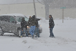 Good Samaritans help push a stranded motorist stuck in deep snow on Stefko Boulevard Thursday, February 13, 2013 in Bethlehem, PA.