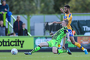 Forest Green Rovers Carl Winchester(7) beats Mansfield Town's CJ Hamilton(22) to the ball during the EFL Sky Bet League 2 match between Forest Green Rovers and Mansfield Town at the New Lawn, Forest Green, United Kingdom on 19 October 2019.