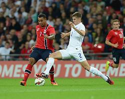 England's John Stones (Everton) tackles Norway's Joshua King  - Photo mandatory by-line: Alex James/JMP - Mobile: 07966 386802 - 3/09/14 - SPORT - FOOTBALL - London - Wembley Stadium - England v Norway - International Friendly