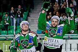 Tomi Mustonen (HDD Tilia Olimpija, #21) and Scott Hotham (HDD Tilia Olimpija, #5) greet fans after ice-hockey match between HDD Tilia Olimpija and HC Znojmo Orli in 24th Round of EBEL league, on November 22, 2011 at Hala Tivoli, Ljubljana, Slovenia. HDD Tilia Olimpija won 5:2. (Photo By Matic Klansek Velej / Sportida)