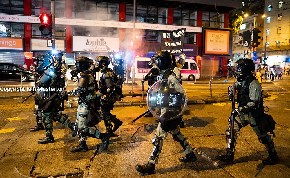 Hong Kong. 6 October 2019. Tens of thousands of pro-democracy protestors march in pouring rain through centre of Hong Kong today from Causeway Bay to Central. Peaceful march later turned violent as a hard-core of protestors confronted police. Pic; Riot police move towards protestors in Causeway Bay.  Iain Masterton/Alamy Live News.
