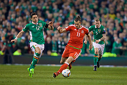 DUBLIN, REPUBLIC OF IRELAND - Friday, March 24, 2017: Wales' Gareth Bale in action against Republic of Ireland's Stephen Ward during the 2018 FIFA World Cup Qualifying Group D match at the Aviva Stadium. (Pic by David Rawcliffe/Propaganda)