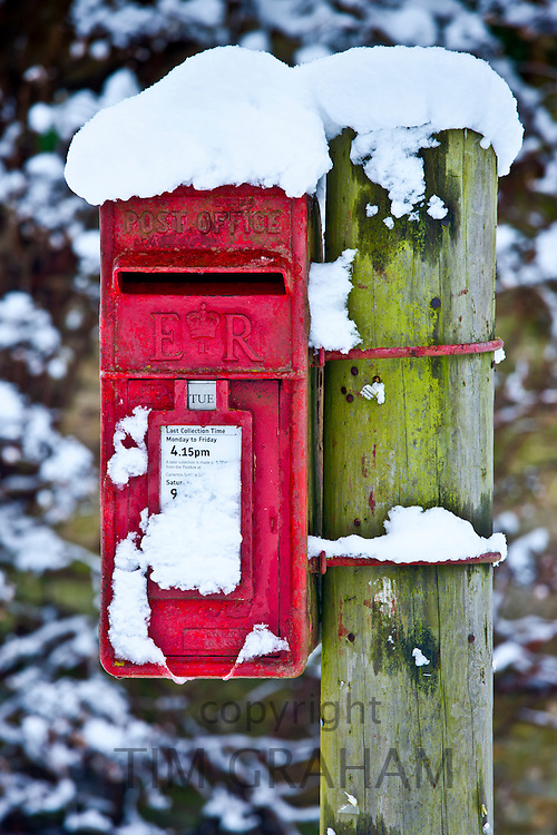 Postbox in snow scene in The Cotswolds, Swinbrook, Oxfordshire, United Kingdom