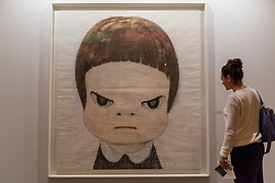 "© Licensed to London News Pictures. 29/06/2016. London, UK.  A woman looks at ""Punch me harder"" by Yoshitomo Nara at the preview, in Chelsea, of Masterpiece London, the leading international fair for art and design from antiquity to the present day with works from 154 world-renowned exhibitors on sale.  The fair is open until 6 July.Photo credit : Stephen Chung/LNP"