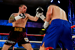 Bristol City fan Josh Baker (maroon shorts) on his way to a draw with Matthew Ashmole (blue shorts) in a Super Welterweight bout on the undercard - Photo mandatory by-line: Rogan Thomson/JMP - 07966 386802 - 13/06/2015 - SPORT - BOXING - Bristol, England - Action Indoor Sports Arena - Lee Haskins vs Ryosuke Iwasa - Interim IBF World Bantamweight Title Fight - UNDERCARD.