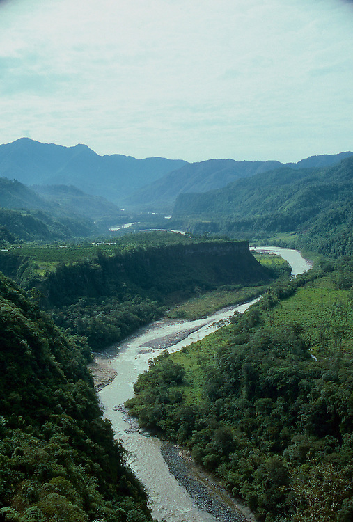 Visa of the Napo River as it leaves the mountains of Ecuador. The cloud forest clings tightly to surrounding hills and peaks.