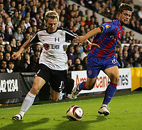 Fotball<br /> England<br /> Foto: Fotosports/Digitalsport<br /> NORWAY ONLY<br /> <br /> Fulham FC vs FC Basel UEFA Europa League 01/10/09<br /> <br /> Fulham's Bjørn Helge Riise battles with Valentin Stocker of Basle.