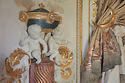 """Detail of putti which opened hands were designed to hold small torchs, and curtain tie backs, Turkish Boudoir, redesigned in 1777 for Marie Antoinette, by architect Richard Mique, Chateau de Fontainebleau, France. The decoration is the achievement of the brothers Rousseau, and the furniture dates to the period of the First Empire, with precious textile work done by Jacob-Desmalter for Empress Josephine. Including a small bedroom, mirrors, and curtains raised by pulleys, this exceptional ensemble has been restored in 2014 thanks to the support of INSEAD and the generosity of subscribers of sponsors belonging to the group """"Des Mécènes pour Fontainebleau"""". Its opening to the public is schedule for Spring 2015. Picture by Manuel Cohen"""