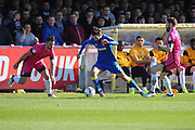 AFC Wimbledon defender George Francomb (7) dribbling and starting an attack during the EFL Sky Bet League 1 match between AFC Wimbledon and Southend United at the Cherry Red Records Stadium, Kingston, England on 25 March 2017. Photo by Matthew Redman.