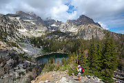 Tourist takes a photo near Surprise Lake, near Amphitheatre Lake, 3000m up in Grand Teton National Park