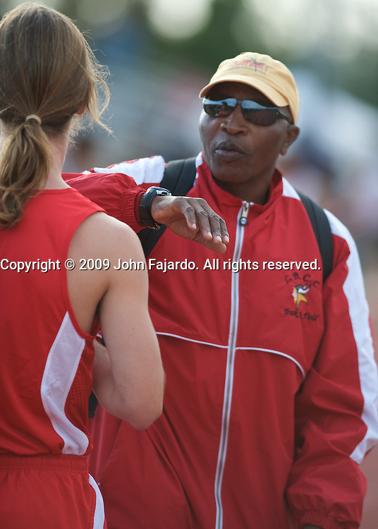 LBCC Mens Cross Country Coach George Mehale discusses technique with runner Nick Yahontov at the Ben Brown Open on March 6 at Cal State Fullerton.