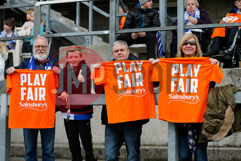 """Bristol Rovers supporters show their """"Play Fair Sainsbury's"""" t'shirts to urge the supermarket to honor their deal to buy the Memorial Stadium and help fund the club's new stadium in Bristol - Photo mandatory by-line: Rogan Thomson/JMP - 07966 386802 - 03/04/2015 - SPORT - FOOTBALL - Bristol, England - Memorial Stadium - Bristol Rovers v Chester - Vanarama Conference Premier."""