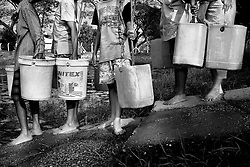 Detail of the plastic buckets used to get the water. At Dala, Yangon Division, Myanmar, 16th February, 2014.