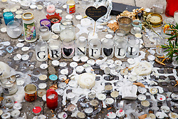 © Licensed to London News Pictures. 01/07/2017. London, UK. Candles left for the victims of the Grenfell Tower fire on Saturday, 1 July 2017 on Latimore Road in west London. Photo credit: Tolga Akmen/LNP