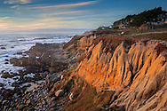 Sunset light on eroded cliffs at Moss Beach, San Mateo County coast, California