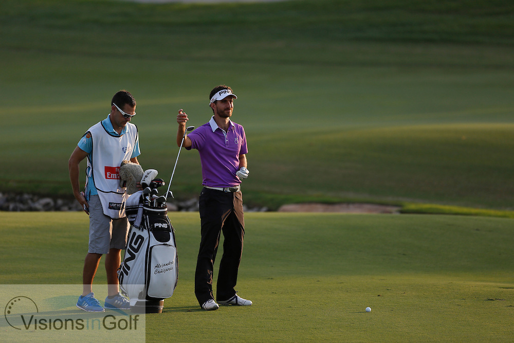 Alejandro Canizares rules infringement after taking a drop going into a water hazard with red stakes marking his place with 2 two clubs lengths and marking with a tee<br /> during the second round of the Race To Dubai DP World Tour Golf Championship, Dubai, UAE November  2013<br /> Picture Credit:  Mark Newcombe / www.visionsingolf.com