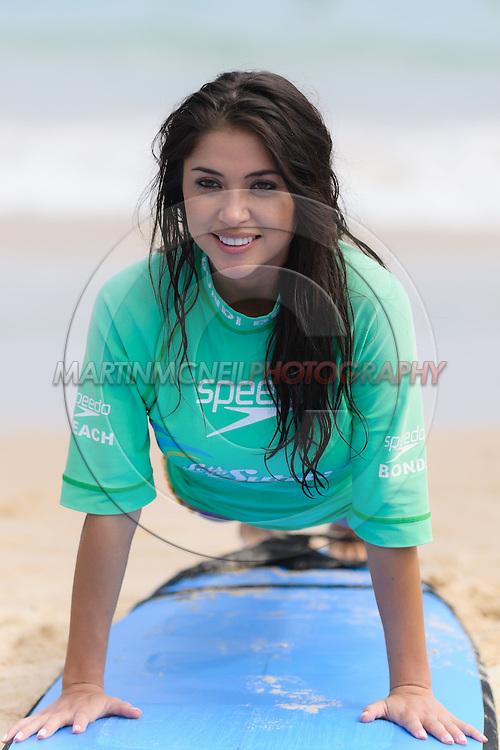 SYDNEY, AUSTRALIA, FEBRUARY 25, 2011: UFC octagon girl Arianny Celeste receives tuition on surfing techniques on  Bondi Beach in Sydney, Australia on February 25, 2011.