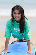 SYDNEY, AUSTRALIA, FEBRUARY 25, 2011: UFC octagon girl Arianny Celeste receives tuition on surfing techniques on  Bondi Beach in Sydney, Australia on February 25, 2011.
