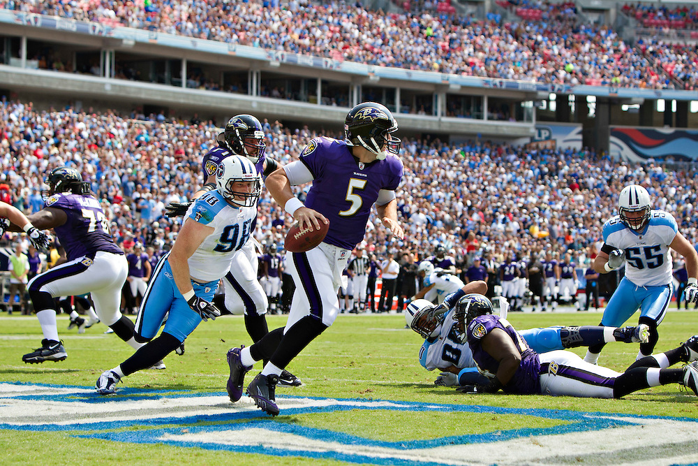 NASHVILLE, TN - SEPTEMBER 18:   Joe Flacco #5 of the Baltimore Ravens scrambles in the end zone to avoid the rush during a game against the Tennessee Titans at LP Field on September 18, 2011 in Nashville, Tennessee.  The Titans defeated the Ravens 26 to 13.   (Photo by Wesley Hitt/Getty Images) *** Local Caption *** Joe Flacco