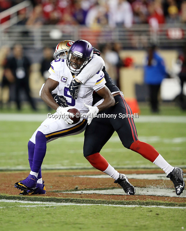 Minnesota Vikings quarterback Teddy Bridgewater (5) gets sacked on a fourth down play by San Francisco 49ers outside linebacker Aaron Lynch (59) stopping a comeback attempt and icing the 49ers win during the 2015 NFL week 1 regular season football game against the San Francisco 49ers on Monday, Sept. 14, 2015 in Santa Clara, Calif. The 49ers won the game 20-3. (©Paul Anthony Spinelli)