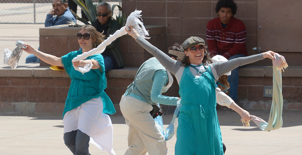 "gbs040217m/ASEC --  Kris Harden, Lucy Silva, Rachel Goldman and Minday Grossberg, from left, all of Albuquerque and members of the ""In the Circle of Women"" organization, dance during the Rally Against Sexual Violence in the Albuquerque Civic Plaza on Sunday, April 2, 2017. (Greg Sorber/Albuquerque Journal)"