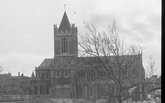 Christchurch Cathedral Dublin..1971..16.04.1971..04.16.1971..16th April 1971..Christ Church Cathedral (or, more formally, The Cathedral of the Holy Trinity) is the cathedral of the United Dioceses of Dublin and Glendalough and the cathedral of the Ecclesiastical province of the United Provinces of Dublin and Cashel in the Church of Ireland.It is situated in Dublin, Ireland and is the elder of the capital city's two medieval cathedrals, the other being St Patrick's Cathedral..It is reputed to have been the idea of King Sitric (Silkenbeard) to build the cathedral c1030. Around the 1180s the Normans rebuilt the old wooden structure in stone and is much as we see it today although some further additions have been added through the years that followed..Once surrounded by medieval streets and buildings, road building and construction now leaves the cathedral looking isolated on the high ground..It was built in a Gothic/Romanesque style and is known throught Europe as a major tourist attraction for visitors to Ireland..Ref; Wikipedia.
