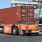 Nederland Zuid-Holland Rotterdam  27-08-2009 20090827 Foto: David Rozing .Serie over logistieke sector.ECT Delta terminal in de haven van Rotterdam. Robotgestuurde wagens vervoeren de containers op de terminal..ECT,European Container Terminals, at the Port of Rotterdam. Europe's biggest and most advanced container terminal operator, handling close to three- quarters of all containers passing through the Port of Rotterdam. ECT is a member of the Hutchison Port Holdings group (HPH), the world biggest container stevedore with terminals on every Continent. At the ECT Delta Terminal unmanned, automated guided vehicles  so called AGVs  transport the containers between ship and stack. In the stack, unmanned automated stacking cranes ( ASCs ) ensure that the containers are always stacked in the correct place. Terminal operations are highly automated for discharging and loading large volumes, , wagons, wereldhandel, werk, werkzaamheden, zeehaven, zeehavens..Holland, The Netherlands, dutch, Pays Bas, Europe .Foto: David Rozing