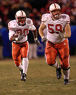 University of Nebraska running back Marlon Lucky (20) rushes down field with lead blocking from center Brett Byford (59) in the second half, during the Big 12 Championship game at Arrowhead Stadium in Kansas City, Missouri, December 2, 2006.  Oklahoma beat Nebraska 21-7.<br />