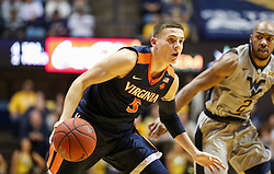 Dec 5, 2017; Morgantown, WV, USA; Virginia Cavaliers guard Kyle Guy (5) dribbles past West Virginia Mountaineers guard Jevon Carter (2) during the first half at WVU Coliseum. Mandatory Credit: Ben Queen-USA TODAY Sports