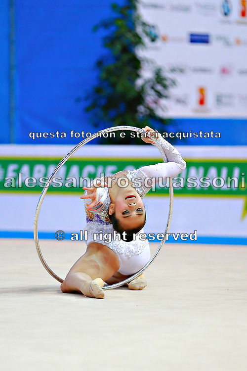 Zeng Laura  during qualifying at hoop in Pesaro World Cup 01 April 2016. Laura was born in Hartford, Connecticut in October 14, 1999. She is an American individual rhythmic gymnast.