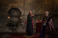 MARTAKERT, NAGORNO-KARABAKH - APRIL 18: Priest Ter-Grigor Markosyan (R) prepares for a baptism in the church at Gandzasar Monastery on April 18, 2015 in Martakert, Nagorno-Karabakh. Since signing a ceasefire in a war with Azerbaijan in 1994, Nagorno-Karabakh, officially part of Azerbaijan, has functioned as a self-declared independent republic and de facto part of Armenia, with hostilities along the line of contact between Nagorno-Karabakh and Azerbaijan occasionally flaring up and causing casualties. (Photo by Brendan Hoffman/Getty Images) *** Local Caption *** Ter-Grigor Markosyan
