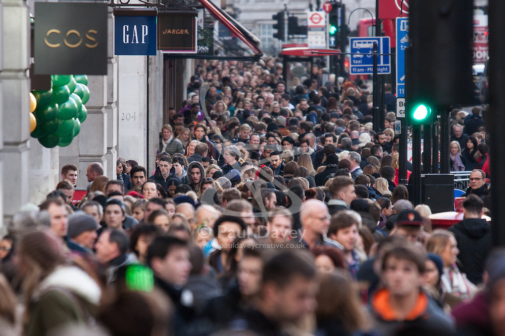"""London, December 20th 2014. Tens of thousands of shoppers descend on central London to scoop up pre-Christmas bargains as retailers offer discount incentives on """"Panic Saturday"""". PICTURED: Crowds of Christmas shoppers pack London's Regents Street"""