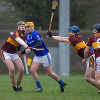 Kilmaley's Cian Moloney is stopped by the Tulla midfield
