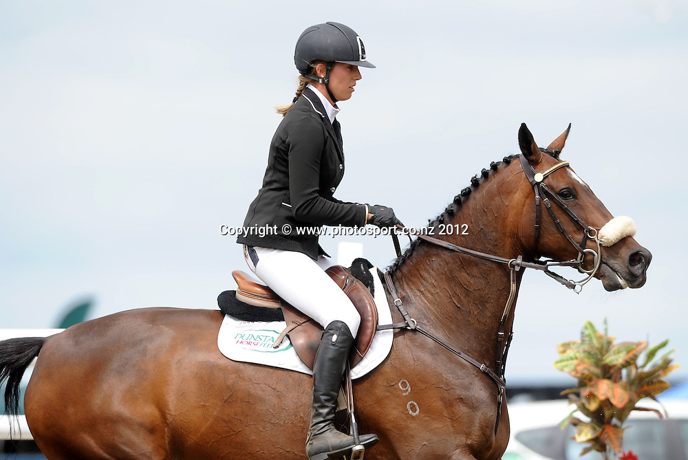Katie McVean, injured with a broken back, rides DUnstan Daffodil in the final round of the NZ FEI World Cup Qualifier, Tauranga, New Zealand. Sunday 05 February 2012. Photo: Kerry Marshall / photosport.co.nz