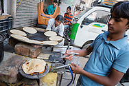 Chapatis are being made on a back street in Paharganj, Delhi.